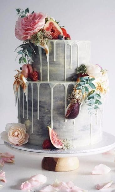 grey wedding cake with flowers and fruits