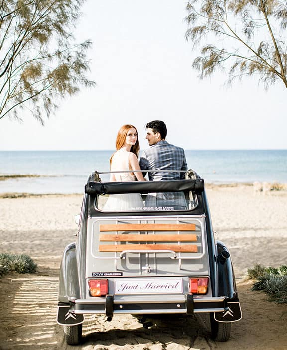 wedding photography bride and groom with a classic car