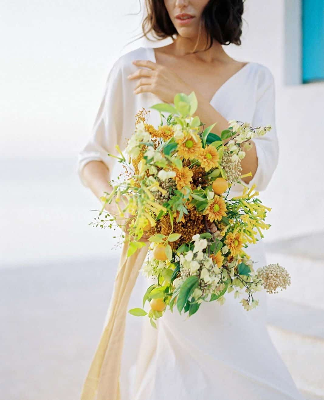 wedding bouquet with yellow chrysanthemums and citrus fruits