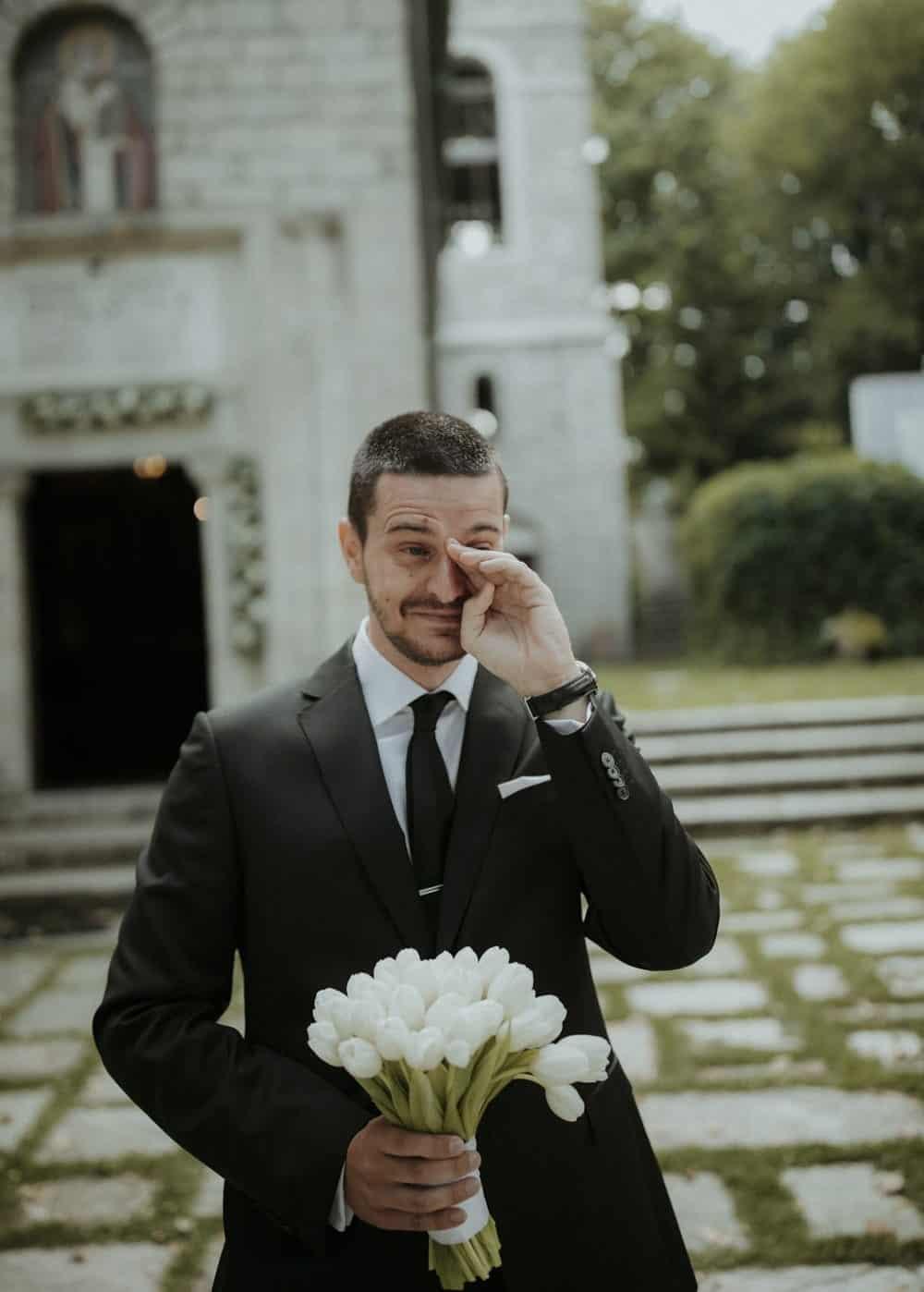 emotional groom waiting the bride
