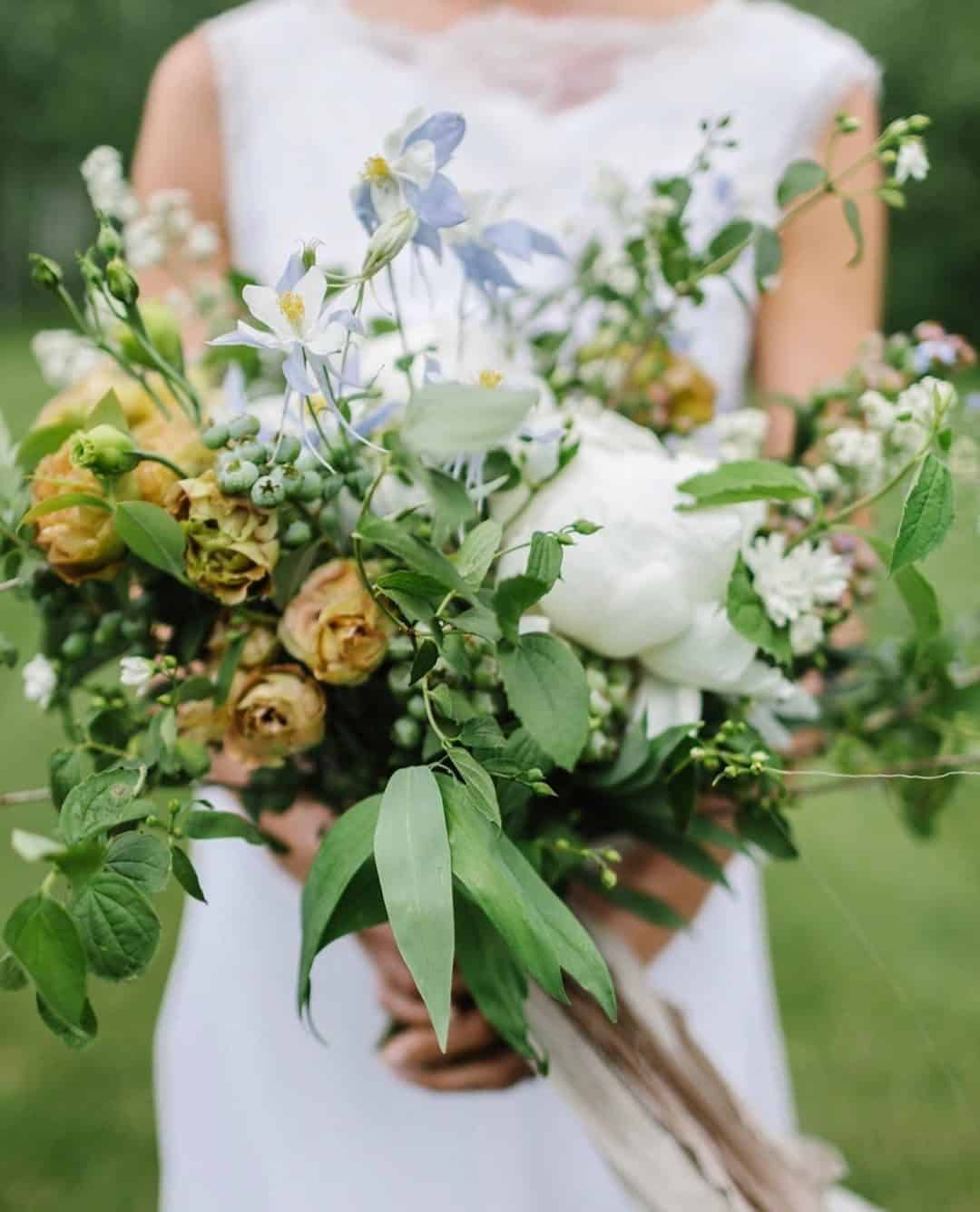 wedding bouquet with roses, lilac matilija poppies