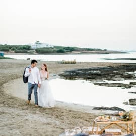 bride and groom walking at the beach