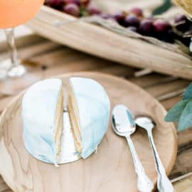 a piece of wedding cake on a wooden plate