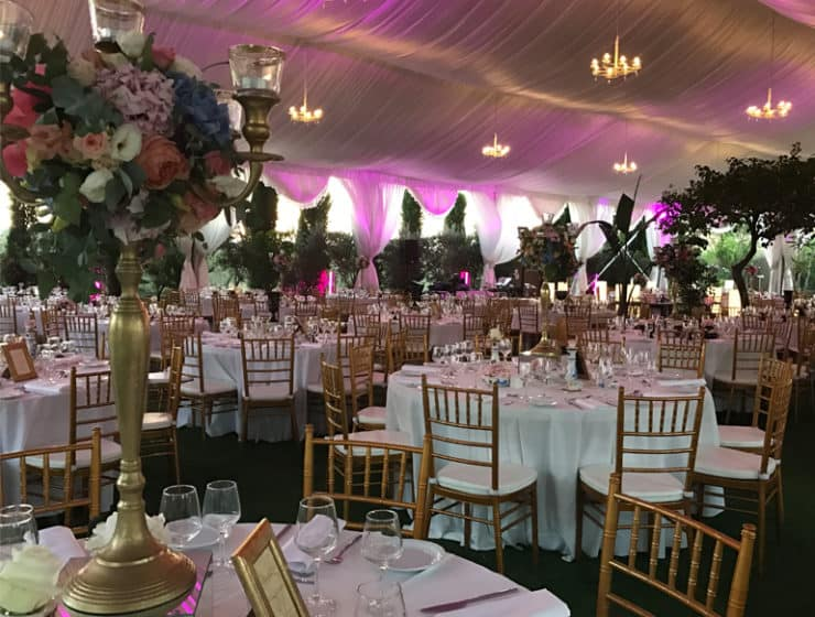 Decorated wedding reception tables by Acropolis Group, which offers venues for hire.