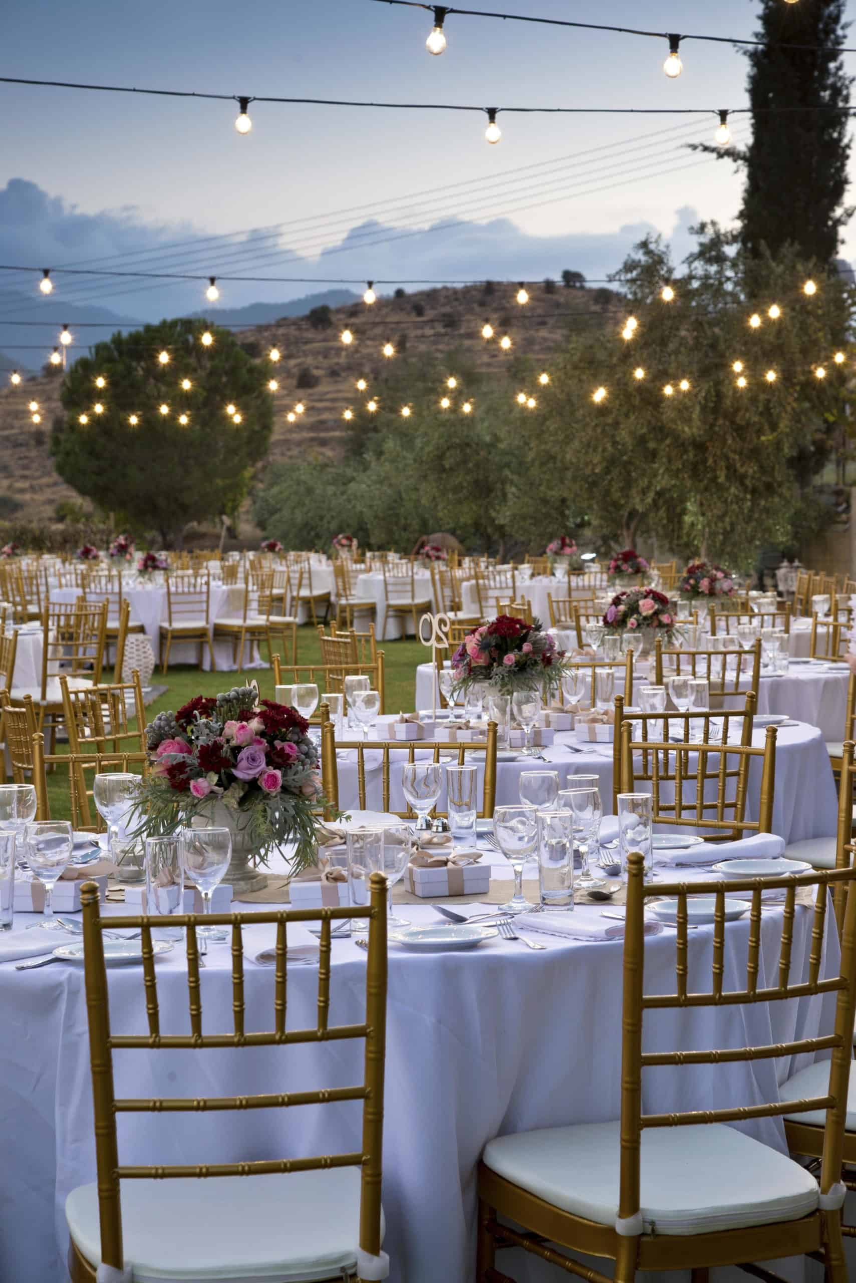 Tables and decorations shown by Aes Ambelis winery for wedding receptions.