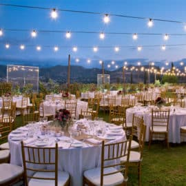 Tables and deocoration shown for a wedding reception at Aes Ambelis Winery.