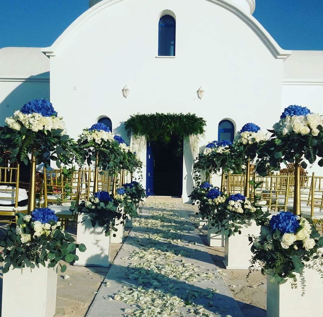 real wedding in Cyprus church decoration with blue hydrangeas and gold details