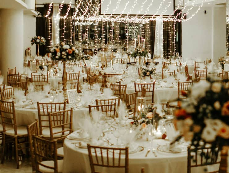 A luxurious wedding reception with hanging fairy lights, at the Boulevard by Occhio.