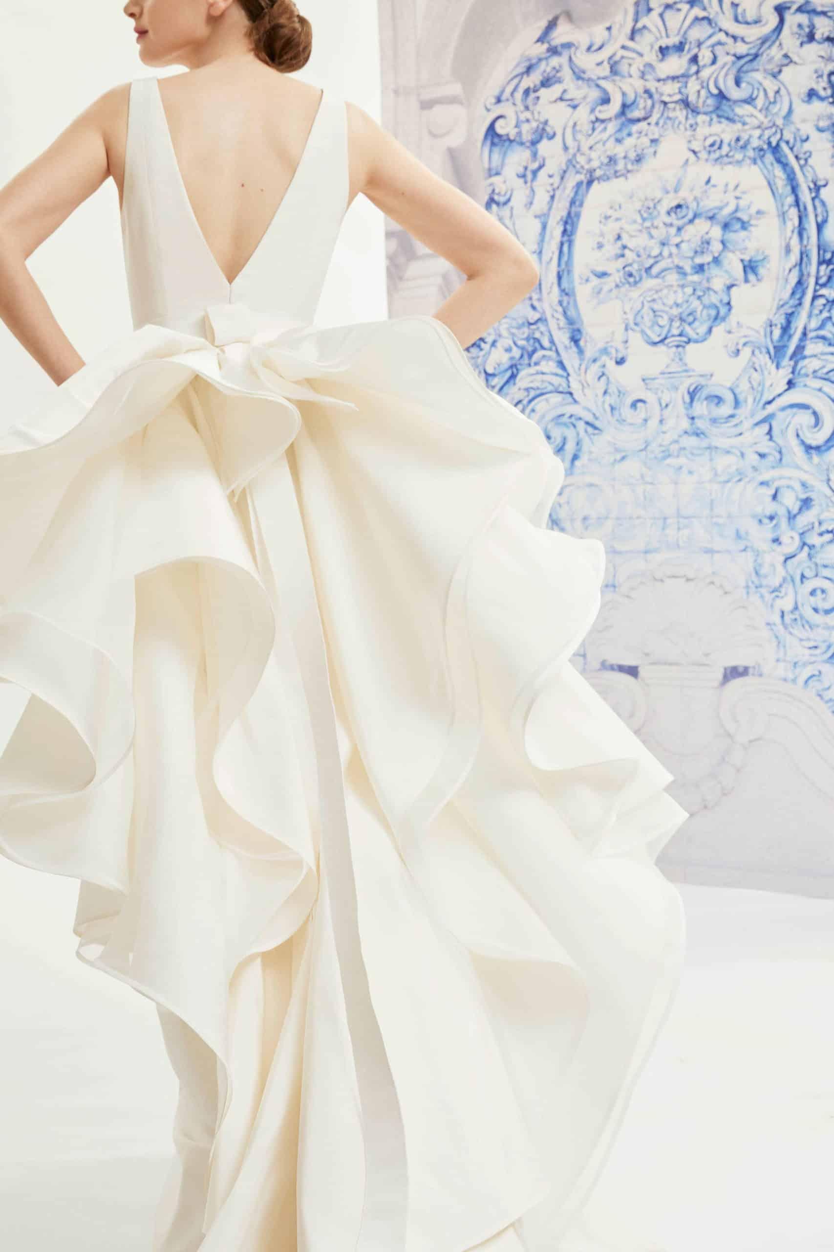 wedding dress with back bow with tail by Carolina Herrera