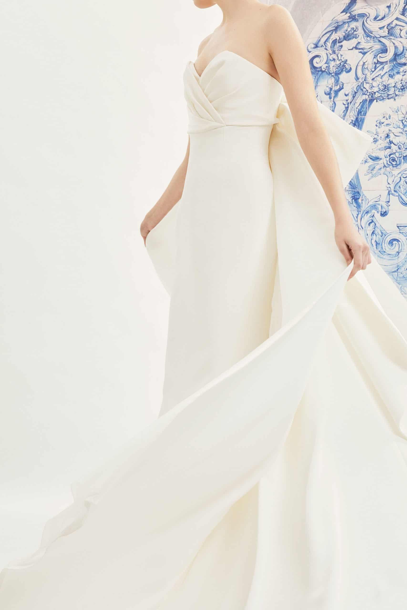 strapless wedding dress with back bow with tail by Carolina Herrera