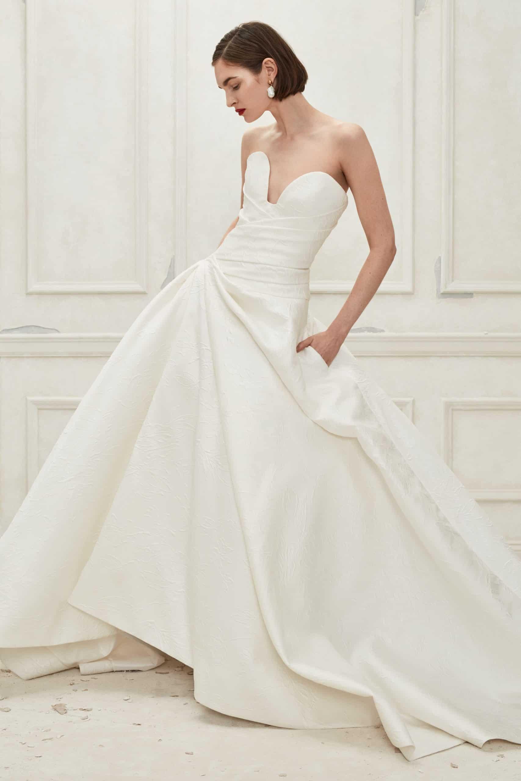 strapless a line silk wedding dress by Oscar de la Renta