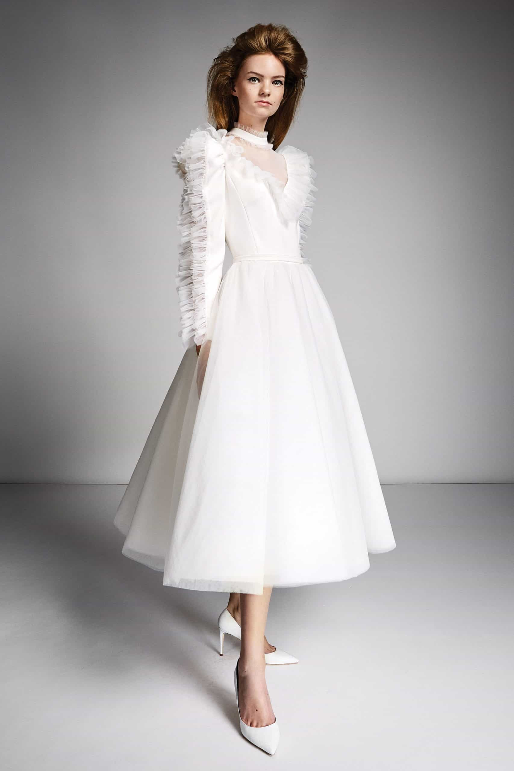 a-line wedding dress with tulle sleeves by Viktor and Rolf