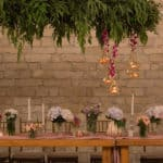 Various flower compositions in glass vasses at a wedding reception, designed by Brilliant Decorations in Cyprus.