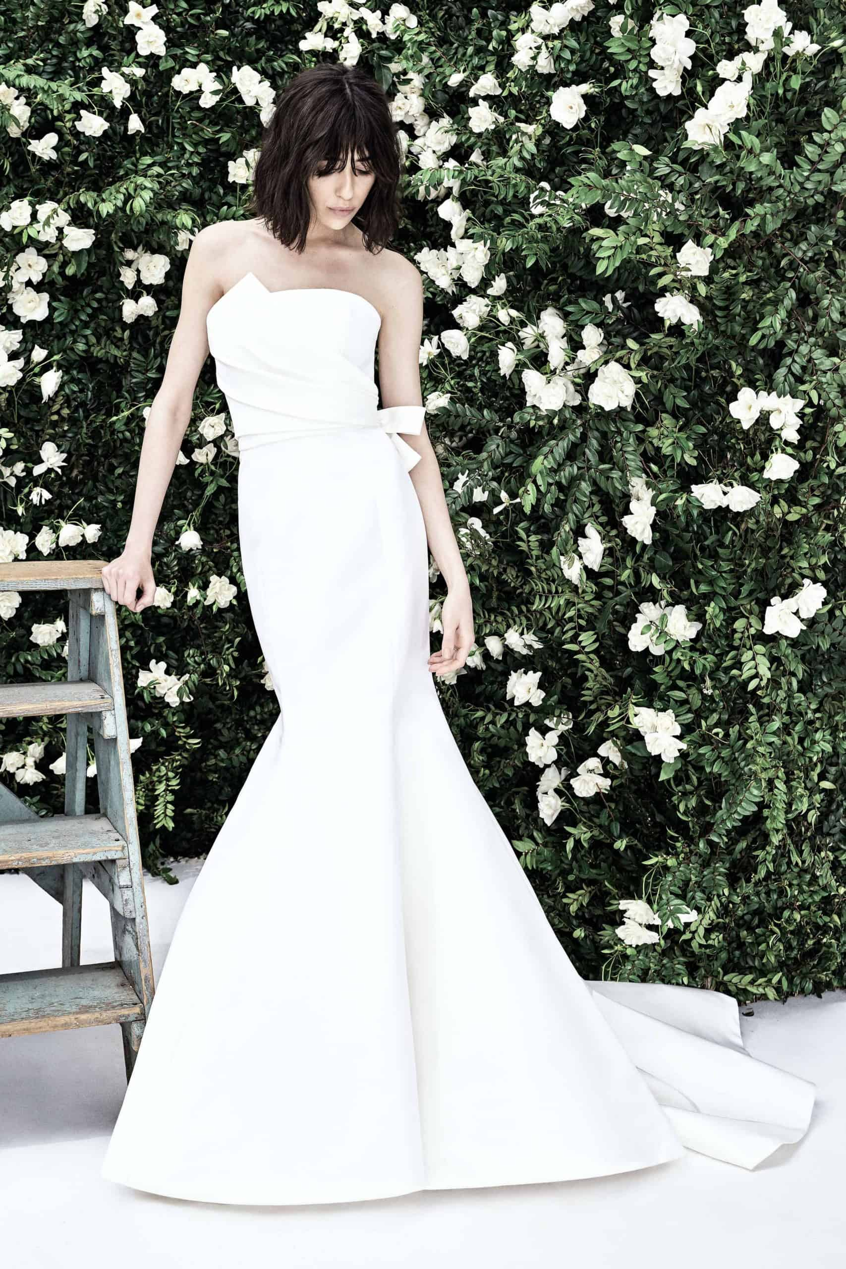 strapless wedding dress with a bow and mermaid  tail by Carolina Herrera