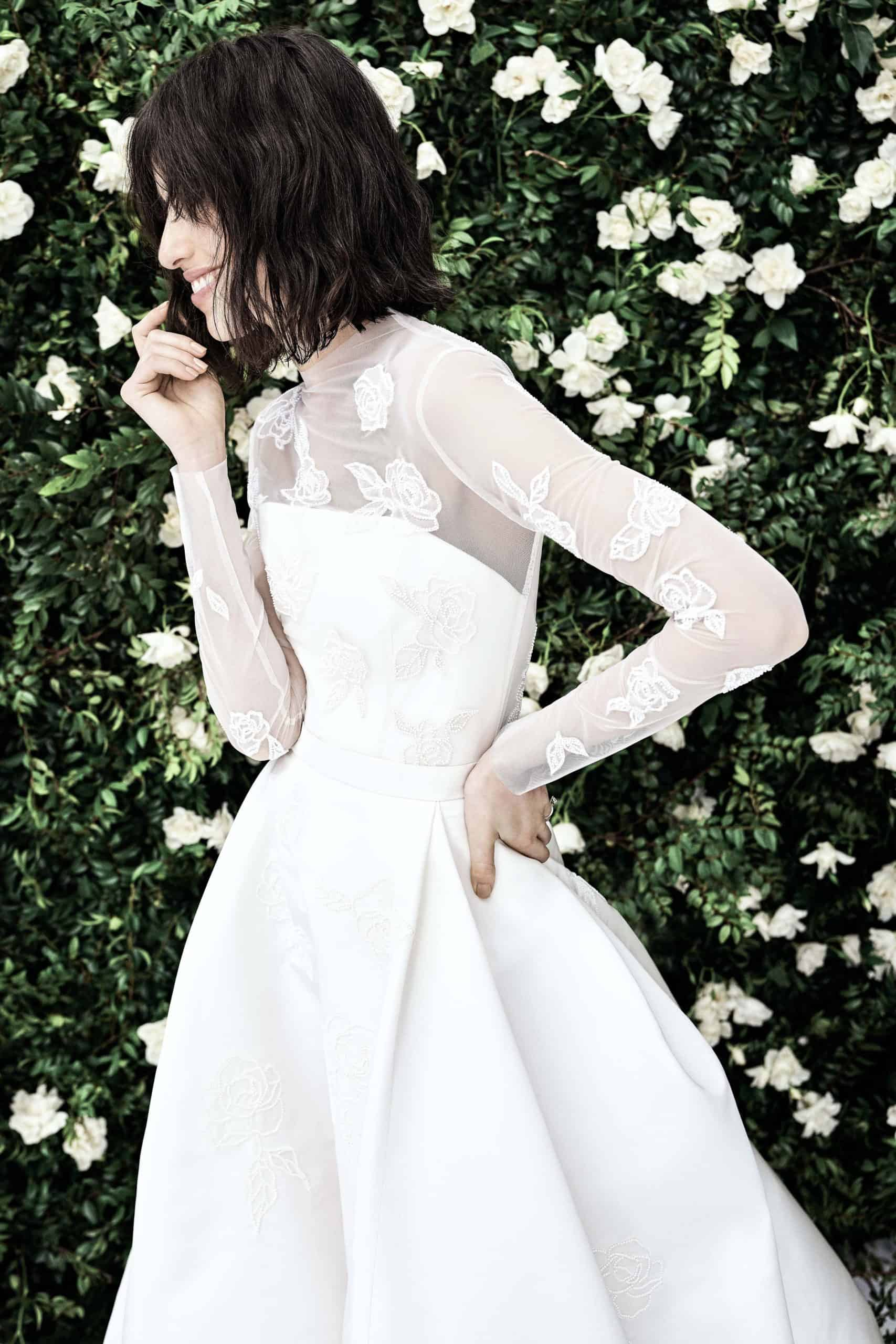 wedding dress with see-through sleeves by Carolina Herrera