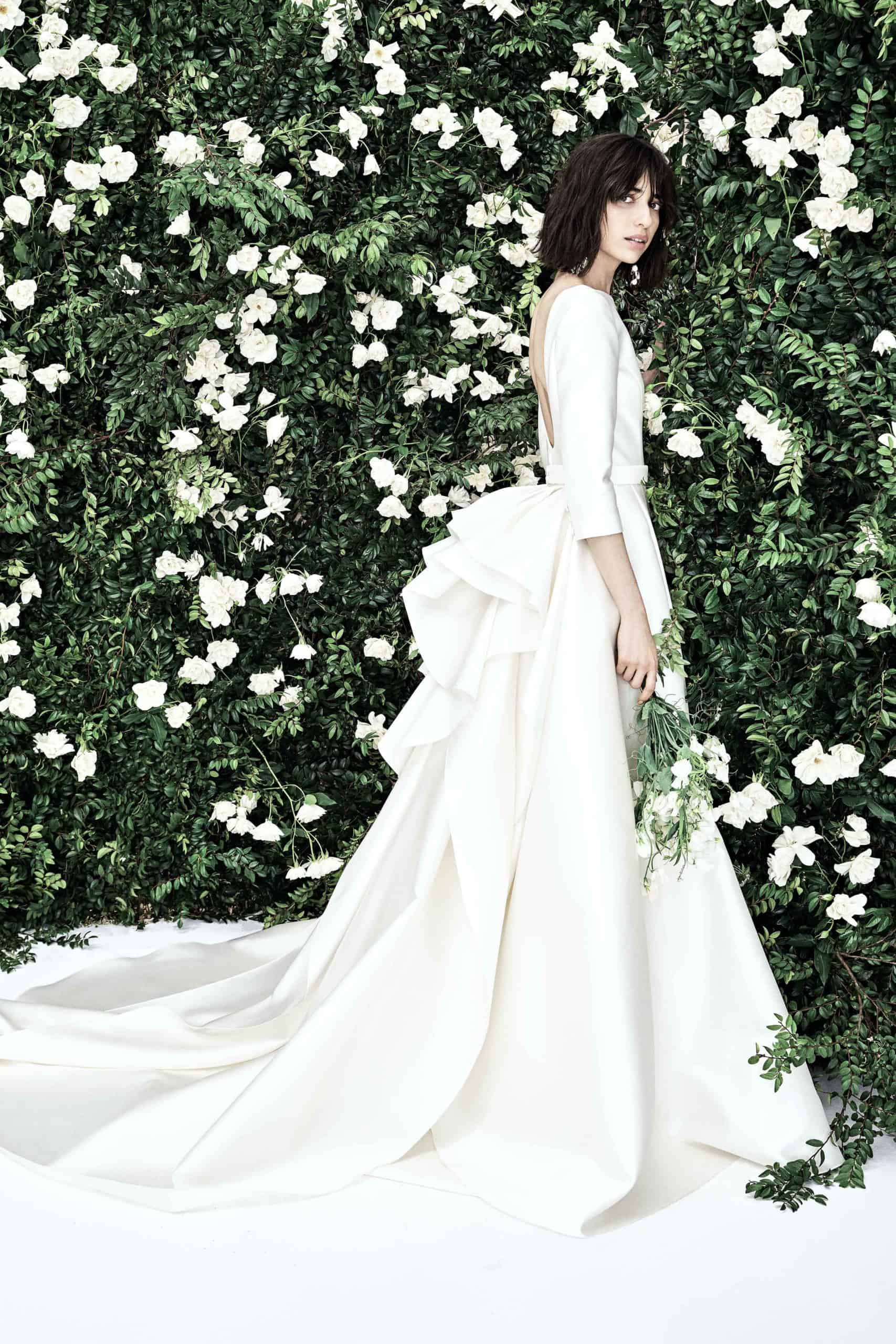 wedding dress with back bow and tail by Carolina Herrera