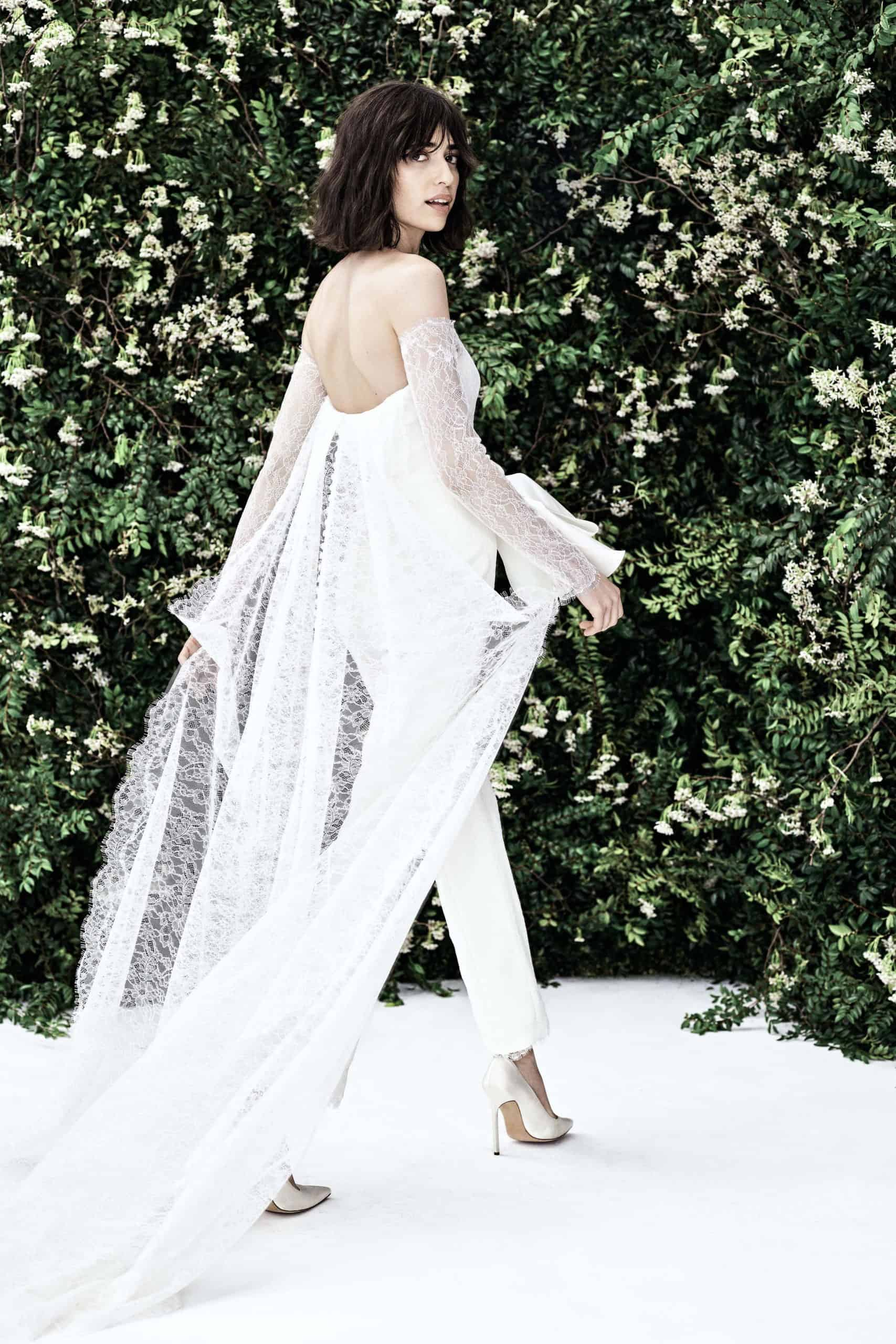 jumpsuit wedding dress with lace sleeves and tail by Carolina Herrera