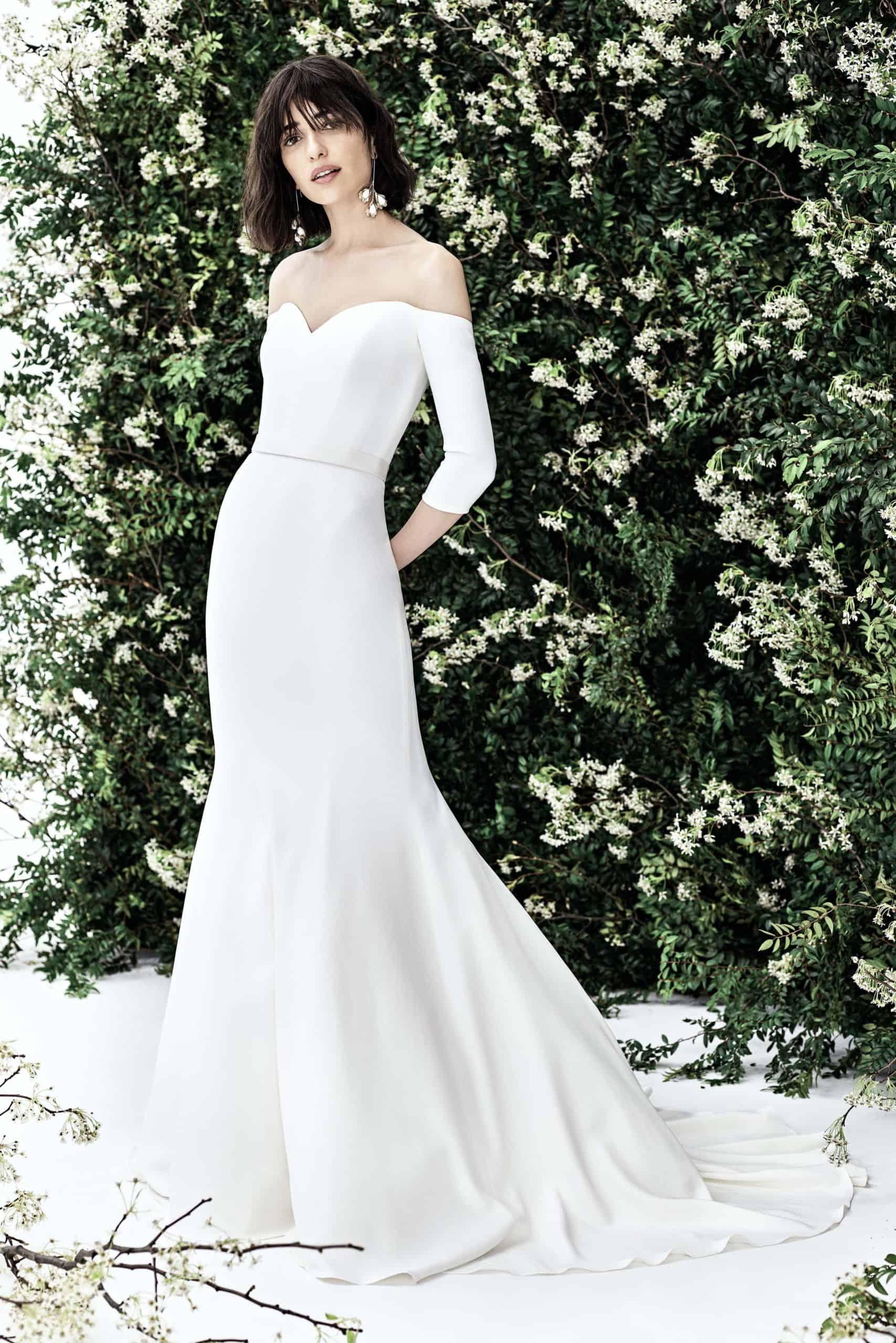 satin wedding dress with long sleeves by Carolina Herrera