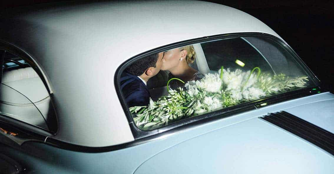 real wedding couple in the wedding car