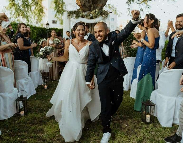 A newlywed couple celebrating after their wedding ceremony, captured by Cinesen Film Studio.