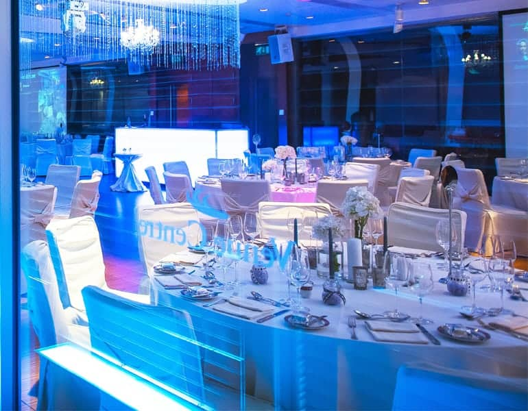 Blue lighting and wedding reception tableware, showcased at Columbia Plaza in Cyprus.