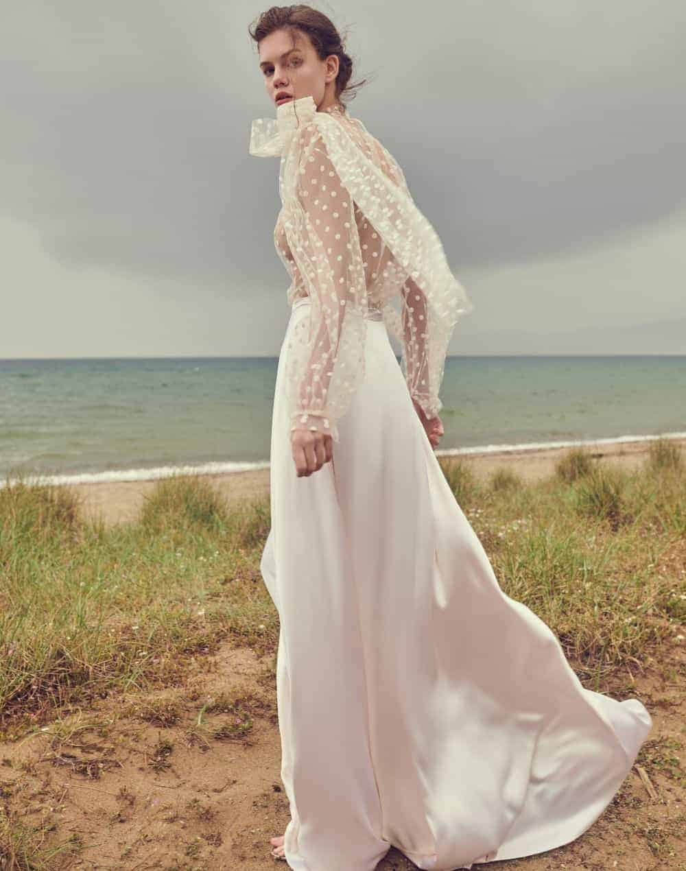 wedding dress with poua see-through top fabric and satin skirt by Costarellos