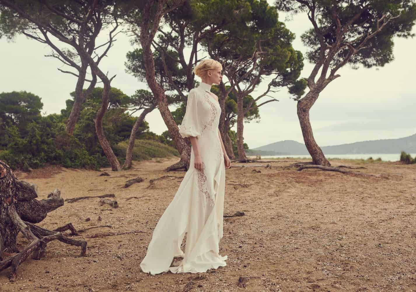 wedding dress with lace and long sleeves by Costarellos