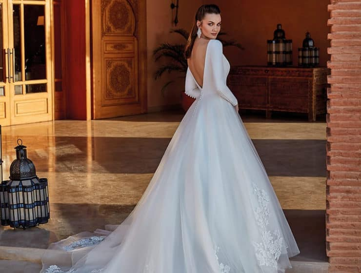 An elegant wedding dress with a tulle tail, by Cupid Bridal Gowns.