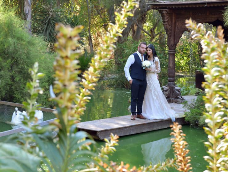 Wedding photoshoot at a lake, with swans and the bride holding her bouquet - Desire Photo Studio in Cyprus.