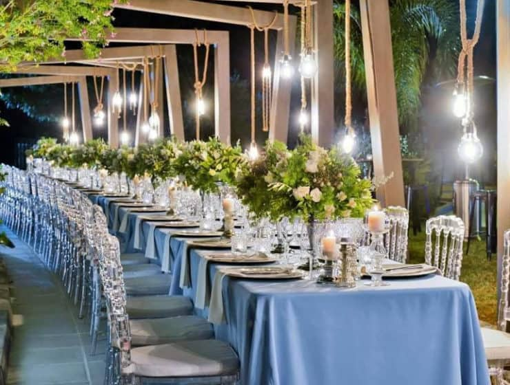 Wedding reception dinner decorated by Food2Impress Catering, in blue and silver colours with table flowers.