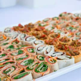 Appetiser rolls on a platter for a wedding dinner, by Giannos Motis Catering Services.