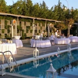 Cooks preparing a wedding reception buffet next to the pool, at the Ginger Group reception venue.