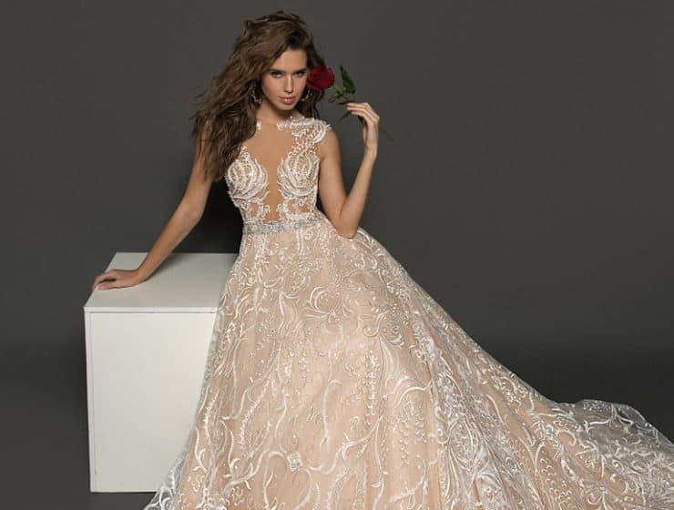 A regal wedding dress with an open top, by Juno Bridal Boutique in Cyprus.