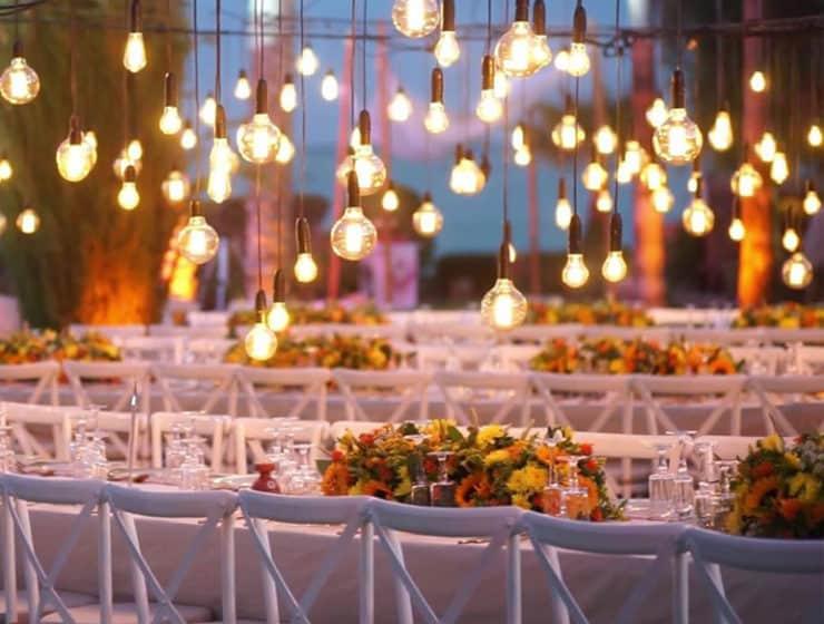 Freeform lightbulbs over wedding tables, designed by Kisomi Lighting.