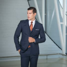 Blue suit with white shirt and red tie, by Kouross Gruim Suits.