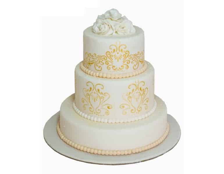 Wedding cake with yellow decorative touches, by La Parfaite Patisserie in Cyprus.