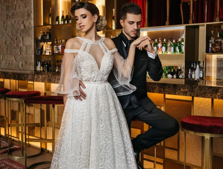 Photoshoot at a bar, showcasing a fashionable wedding dress designed by Lenia Haute Couture.