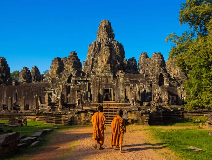 Ancient Buddhist temple ruins and two Buddhist monks, part of a honeymoon trip offered by Let's Go Tours by Amathus.
