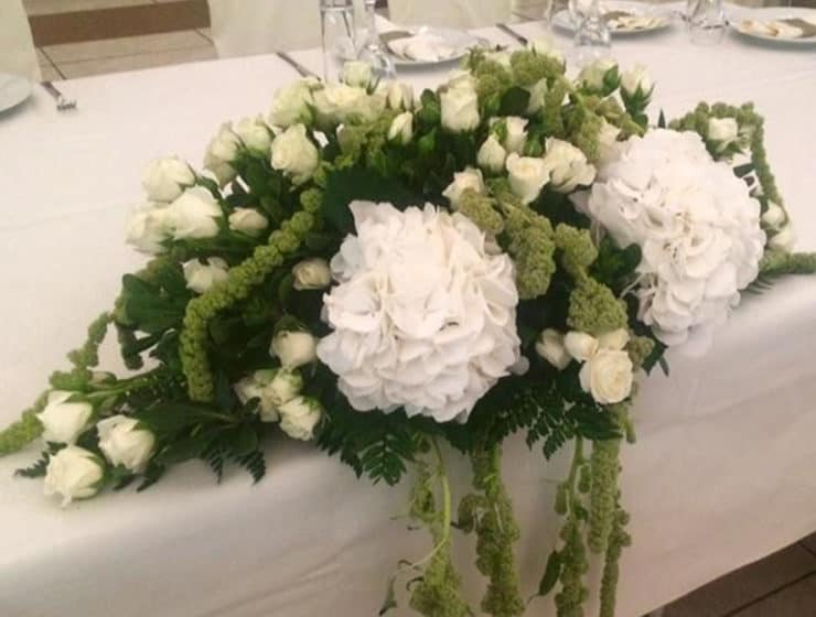 White flower table decorations at a wedding reception, made by Manentzos Garden Centre.