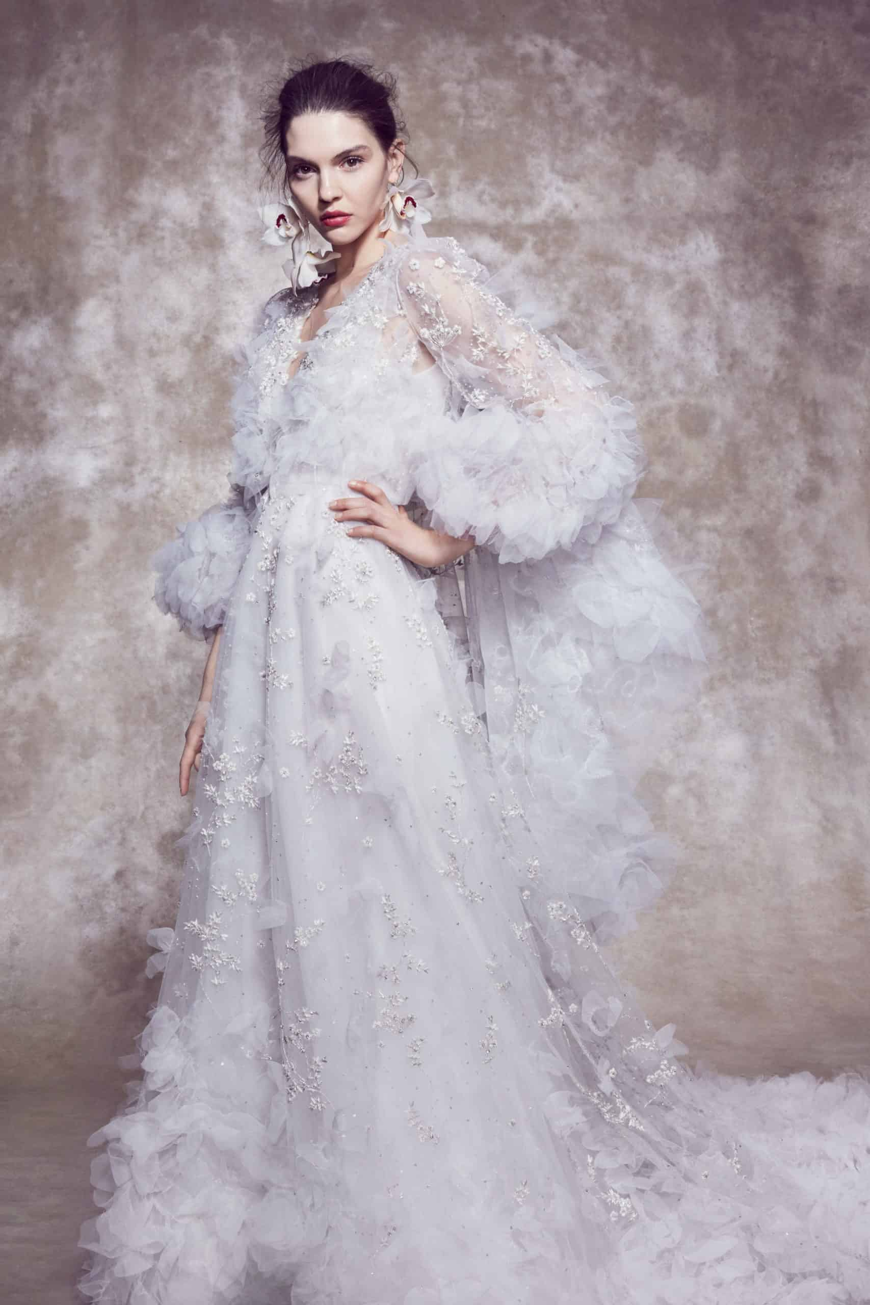tulle wedding dress with embossed flowers and long sleeves by Marchesa