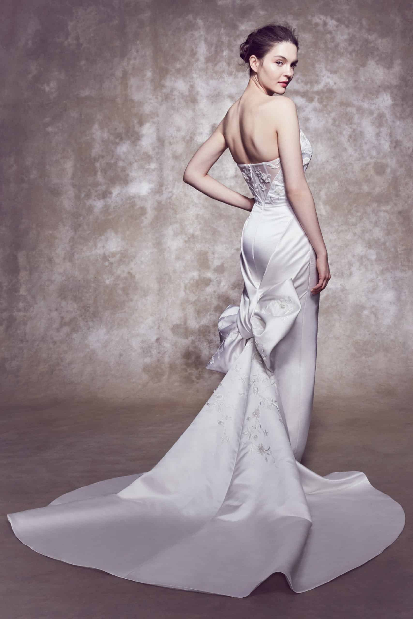 strapless wedding dress with bow tail by Marchesa