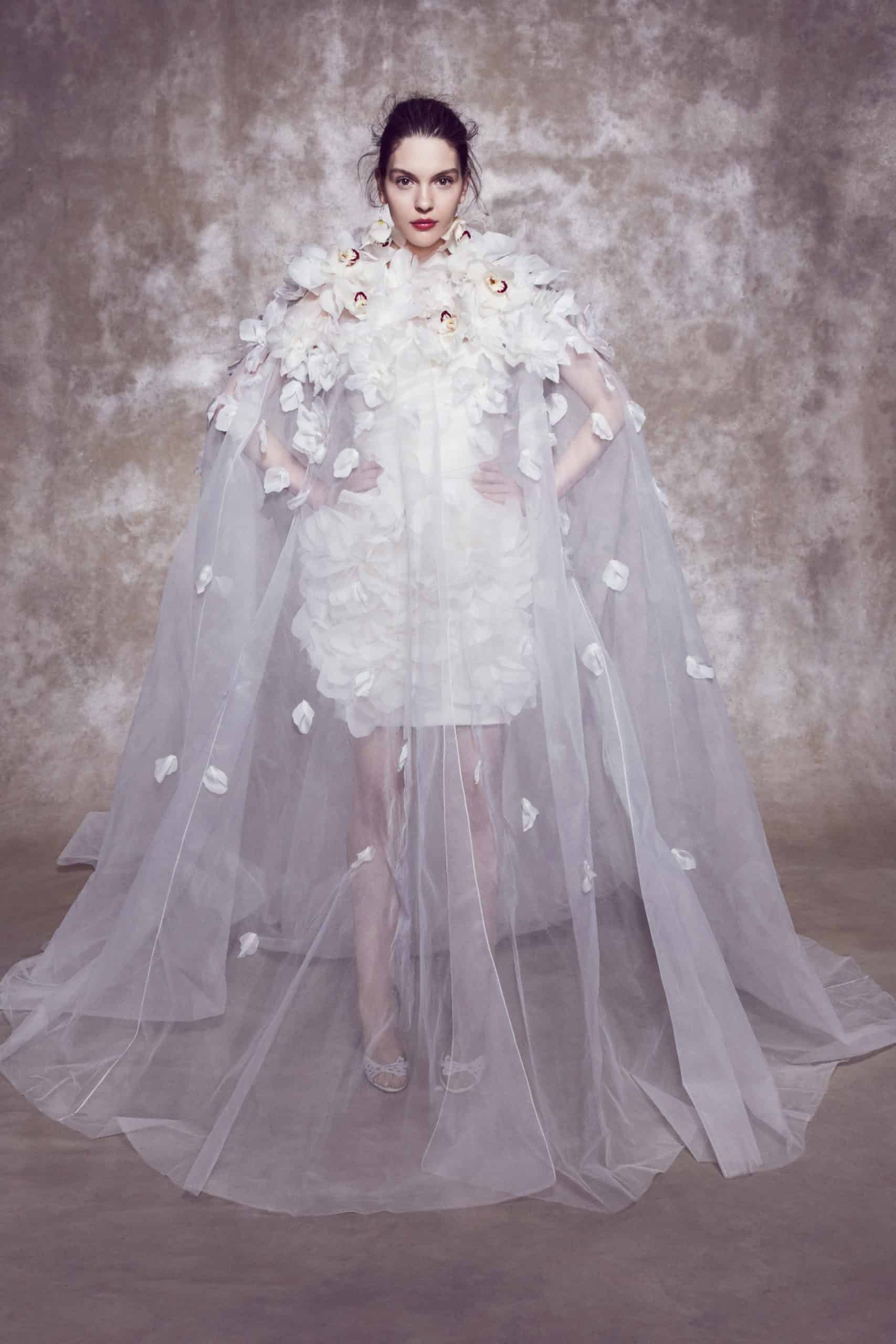 short laced wedding dress with tulle cape and 3d flowers by Marchesa