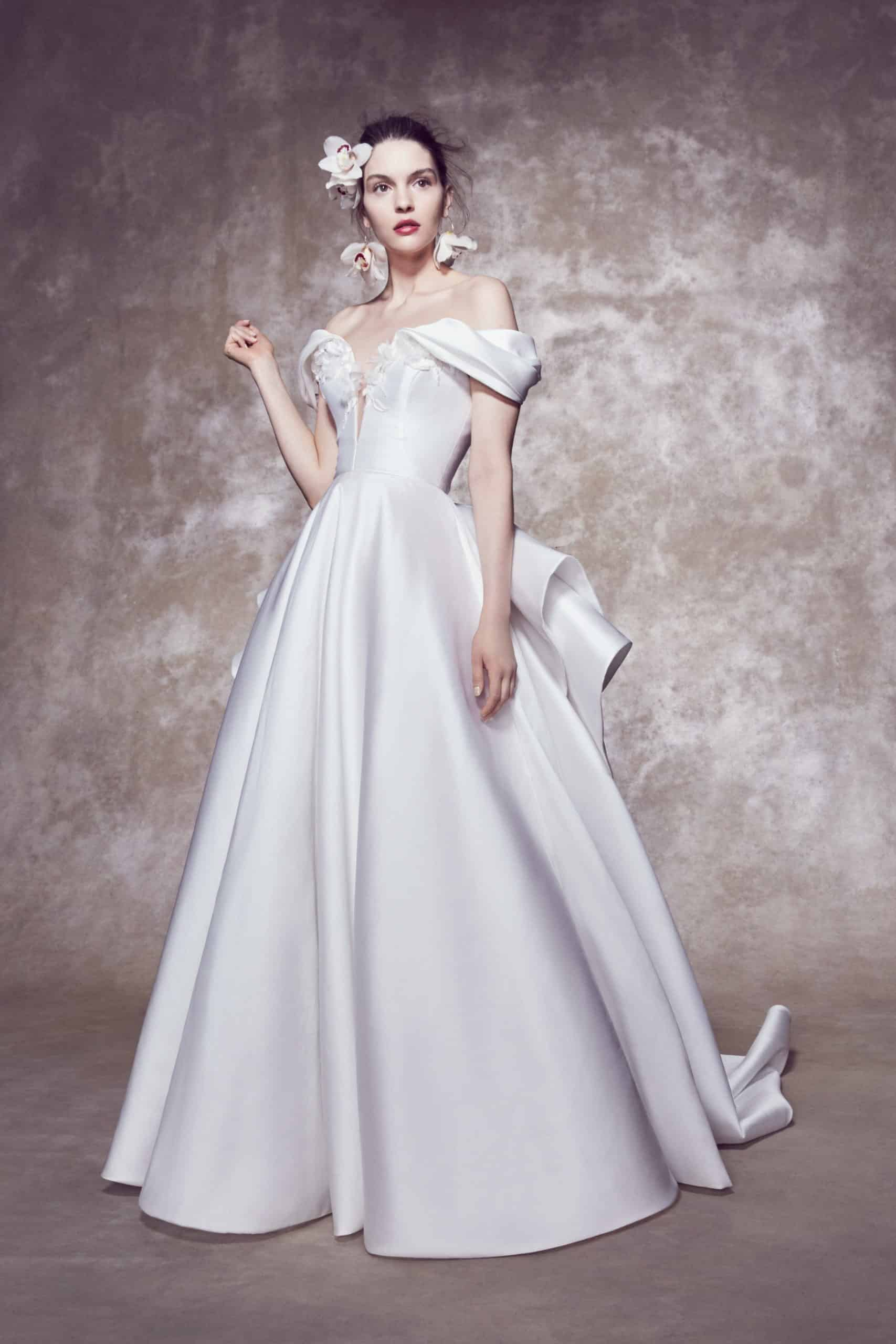 a-lined wedding dress with a back bow with a tail by Marchesa