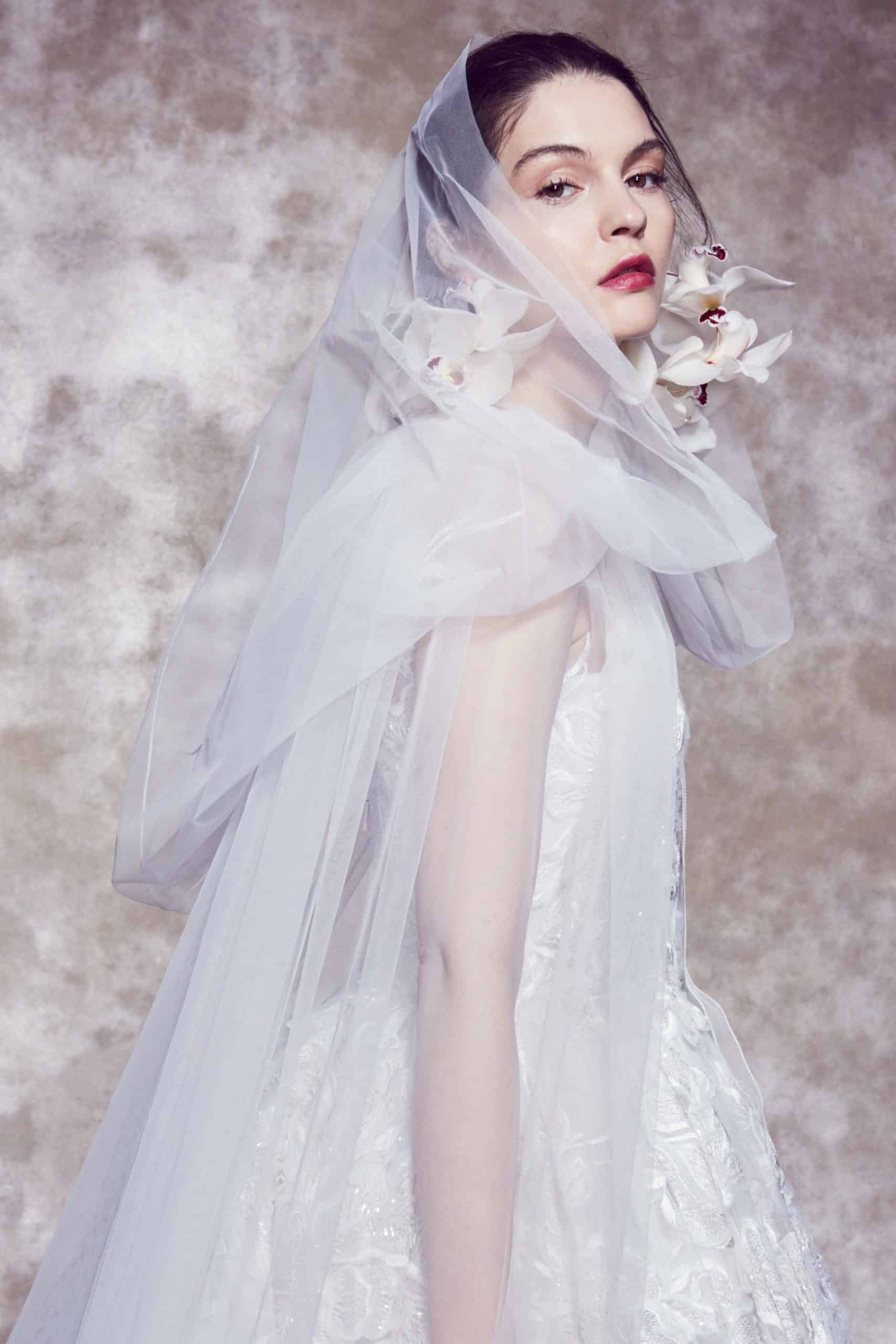 laced wedding dress with tulle veil