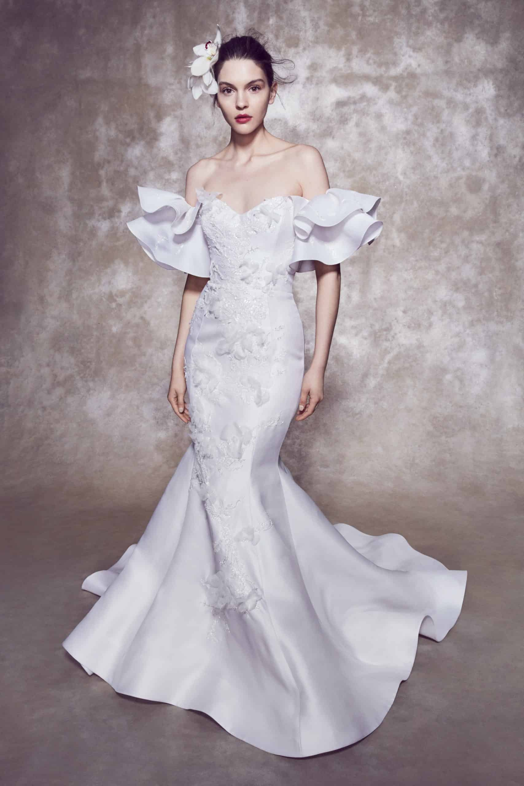 wedding dress with mermaid line strapless and large sleeves  by Marchesa