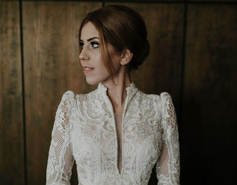 High-neck, open wedding dress, showcasing the top part, design by Mariancchi Bridal.