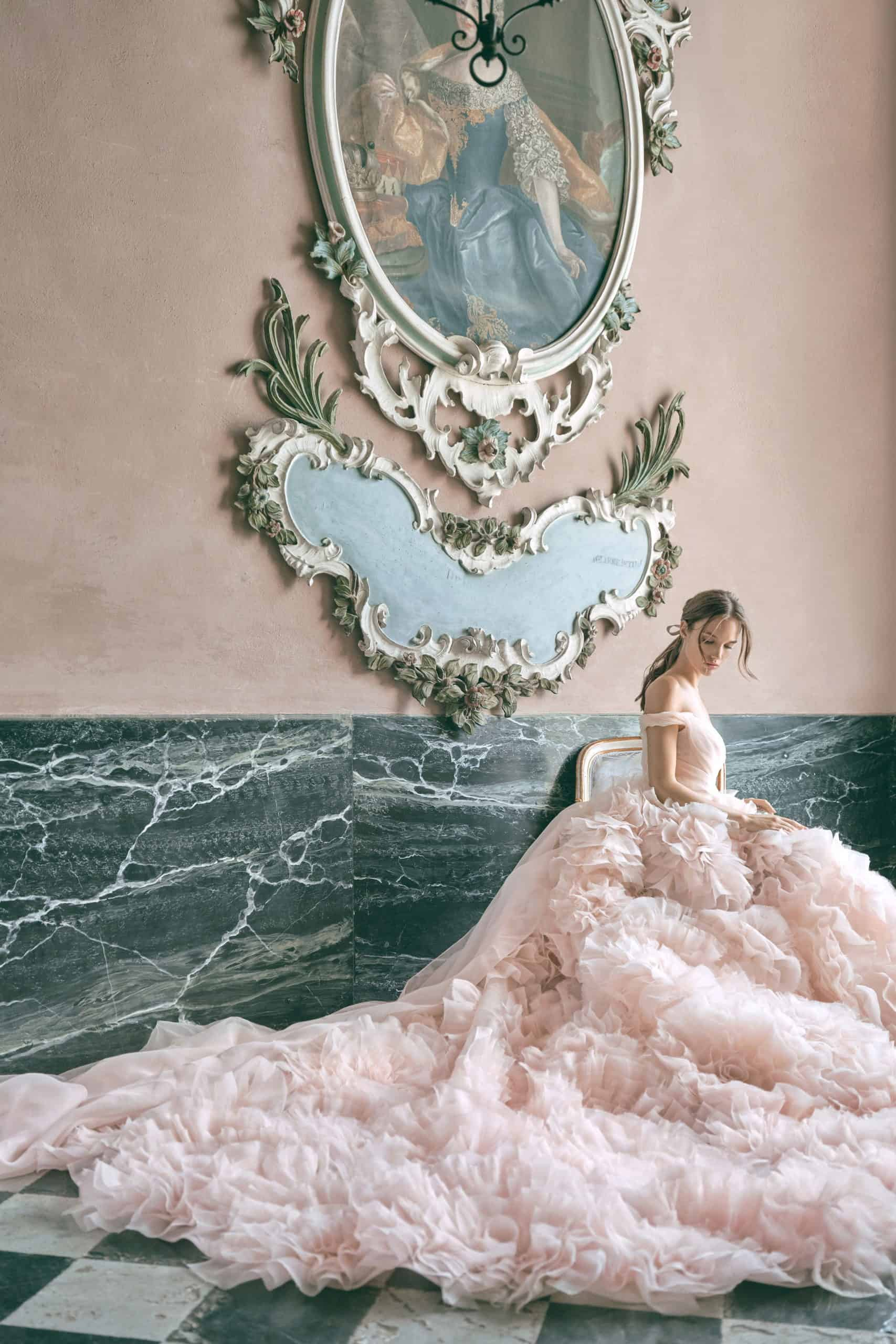 pink wedding dress with extra volume skirt by Monique Lhuillier
