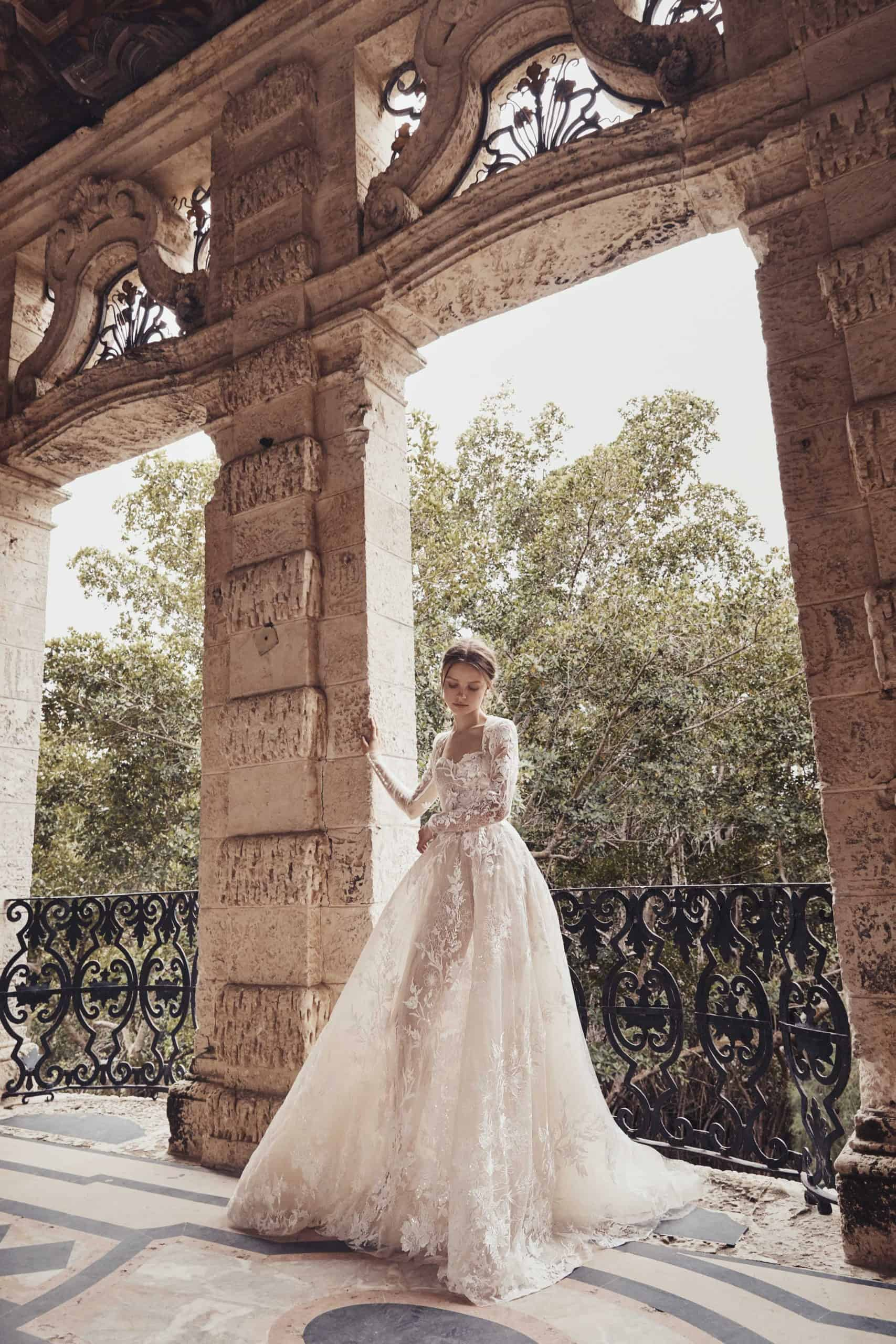 wedding dress with see-through tulle with lace by Monique Lhuillier