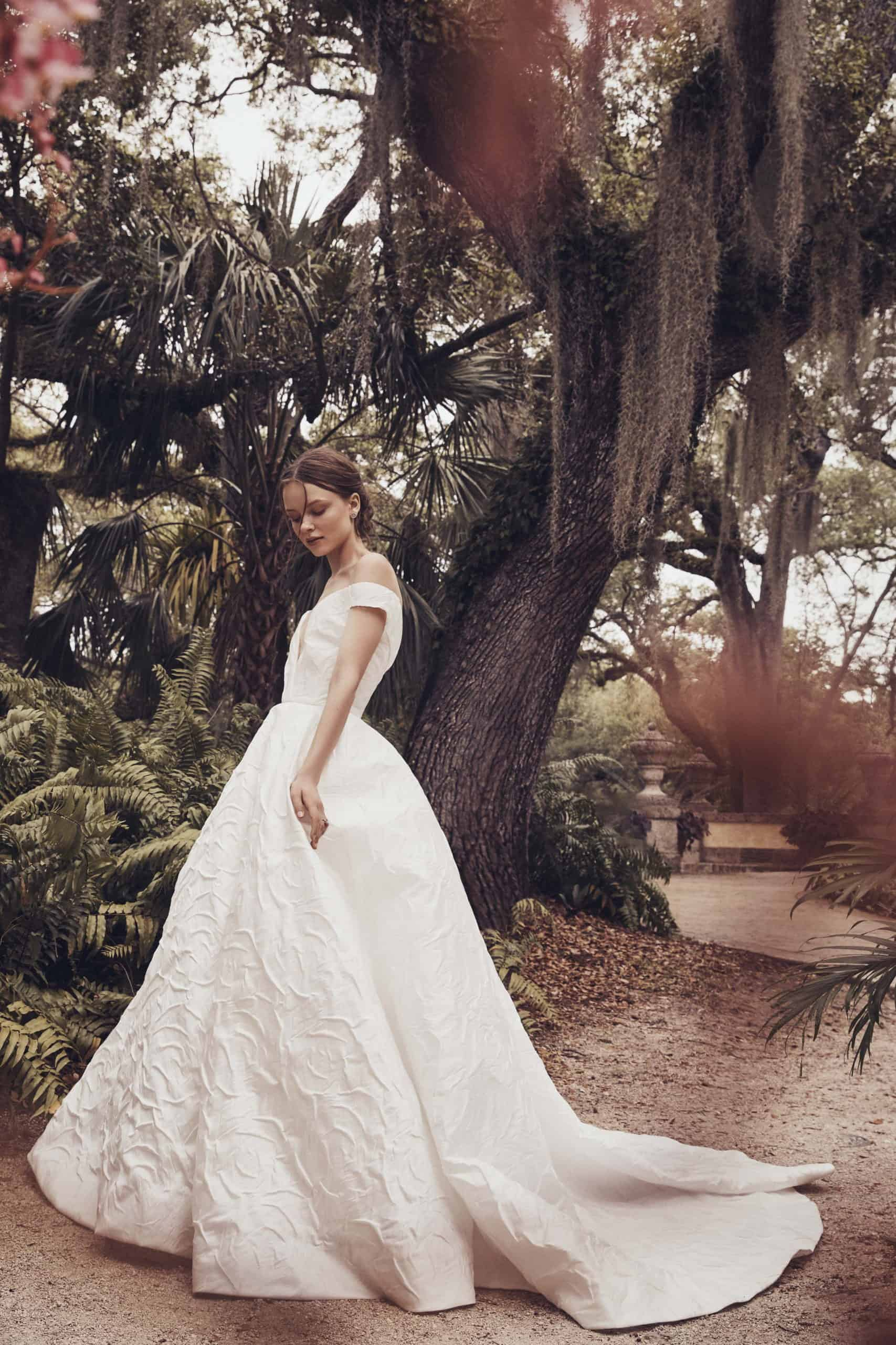 a-lined wedding dress with heavy lace by Monique Lhuillier