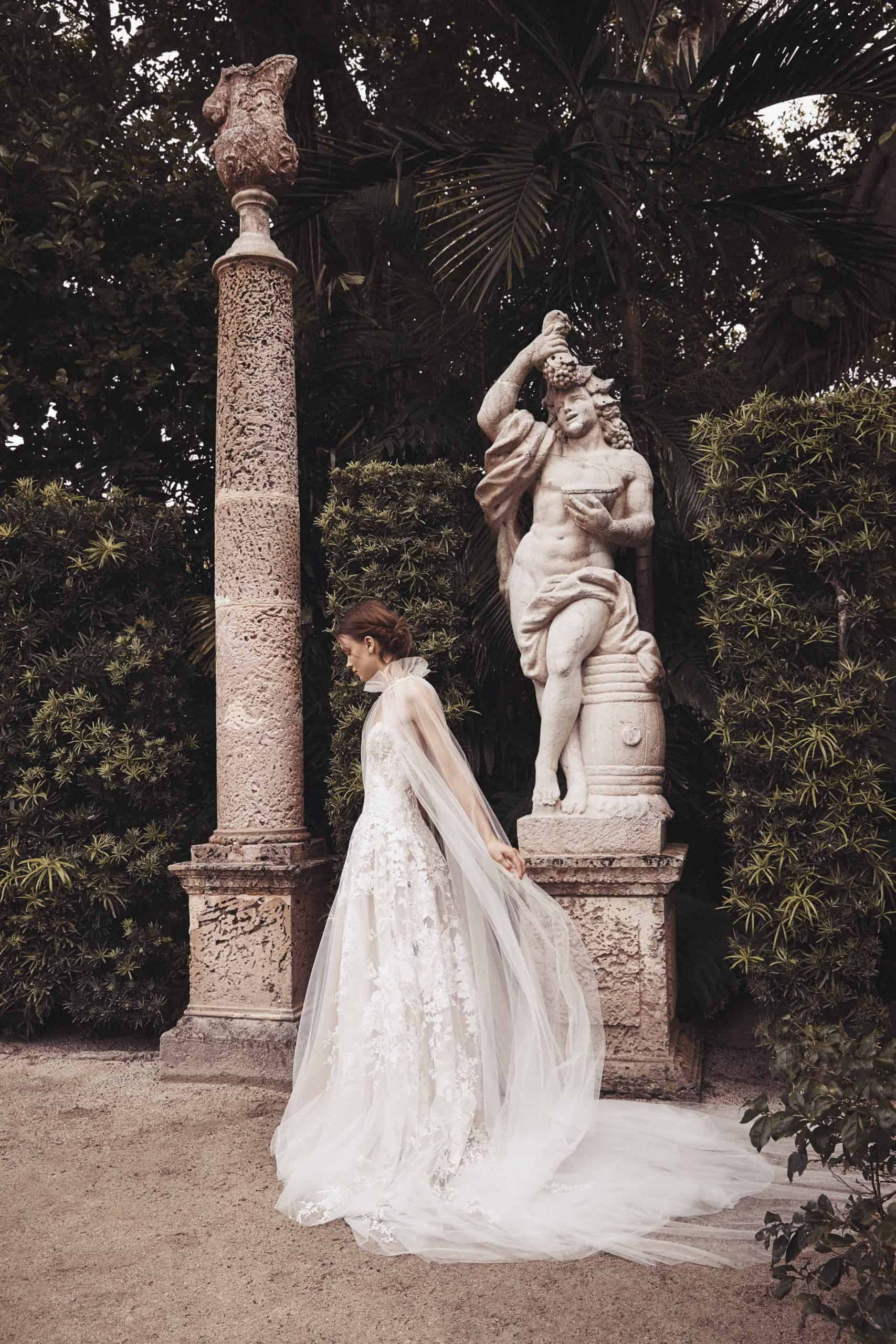 wedding dress with tulle and embossed flowers with tulle collar and cape by Monique Lhuillier
